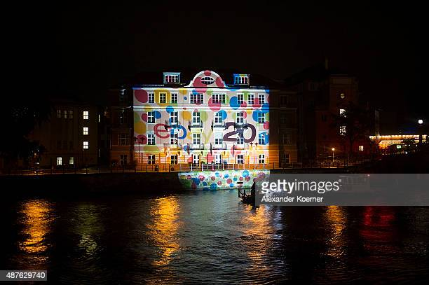 Buildings along the river Spree in downtown Berlin are illuminated to celebrate the 20th jubilee of eBay on September 10 2015 in Berlin Germany Swiss...