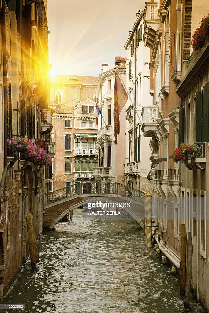 Buildings and bridge on urban canal : Stock Photo