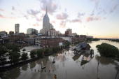 Buildings and city streets are still under floodwater as the sun sets on May 4 2010 in Nashville Tennessee More than 13 inches of rain fell over two...