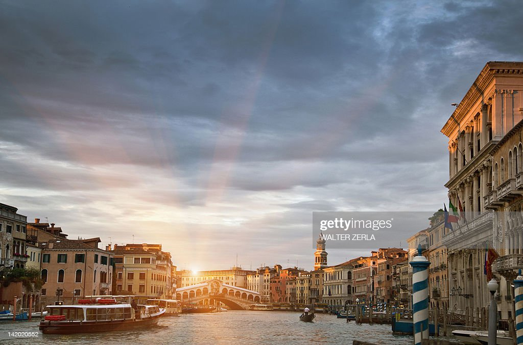 Buildings and ferryboat on urban canal : Stock Photo