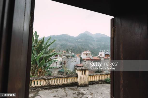 Buildings And Mountains Seen From House