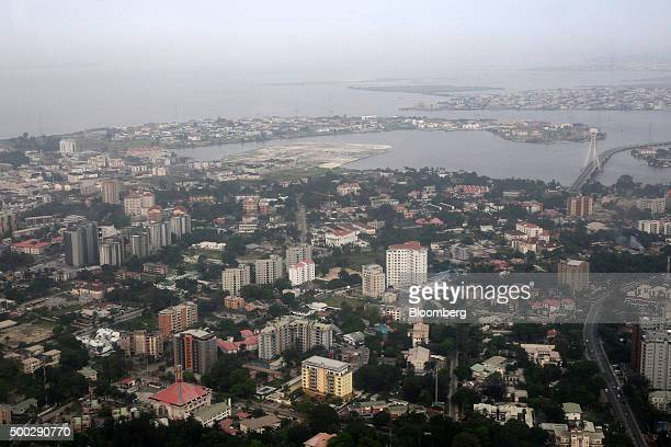 Buildings and roads sit on the coast in this aerial view of Ikoyi in Lagos island a residential area in Lagos Nigeria on Monday Nov 16 2015 Nigeria...