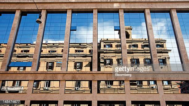 Buildings are reflected in the windows of the Banca d'Italia Italy's central bank in Rome Italy on Wednesday May 30 2012 Making Italy's labor markets...