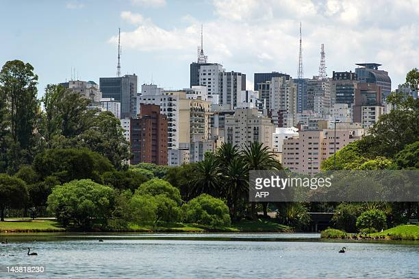 Buildings are seen behind the Ibirapuera Park in Sao Paulo Brazil on February 29 2012 AFP PHOTO/Yasuyoshi CHIBA