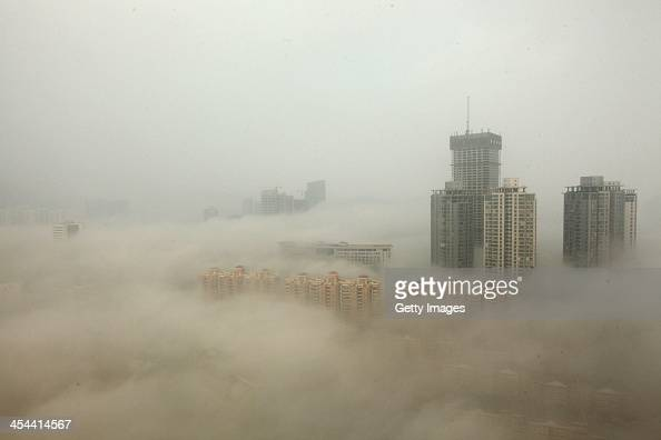 Buildings are shrouded in smog on December 8 2013 in Lianyungang China Heavy smog has been lingering in northern and eastern parts of China since...