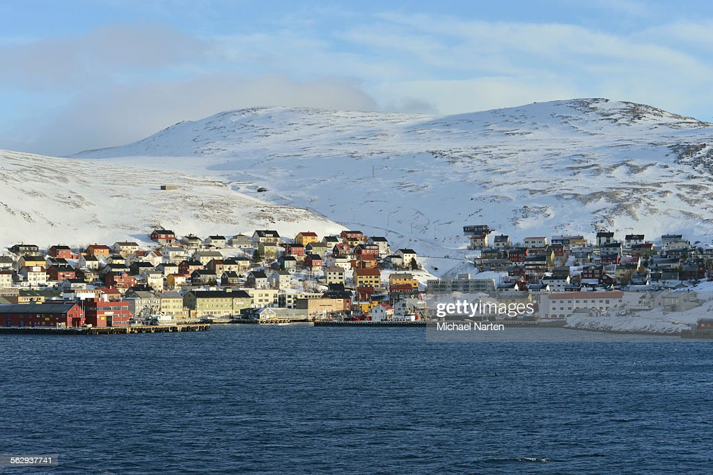 Buildings at the harbour in front of the mountains of the island, Honningsvag, Mageroya island, Finnmark County, Norway