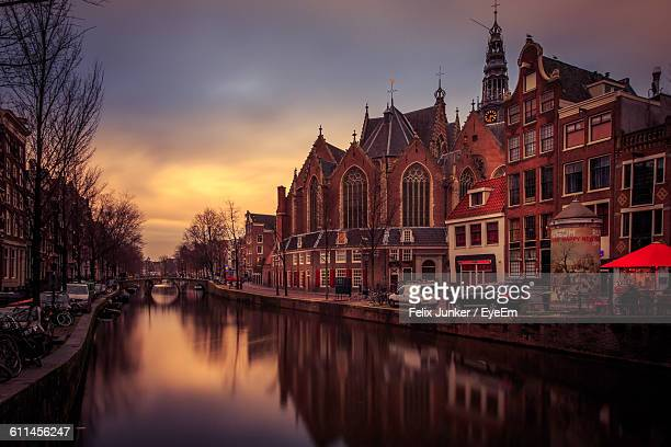 Buildings By Canal During Sunset