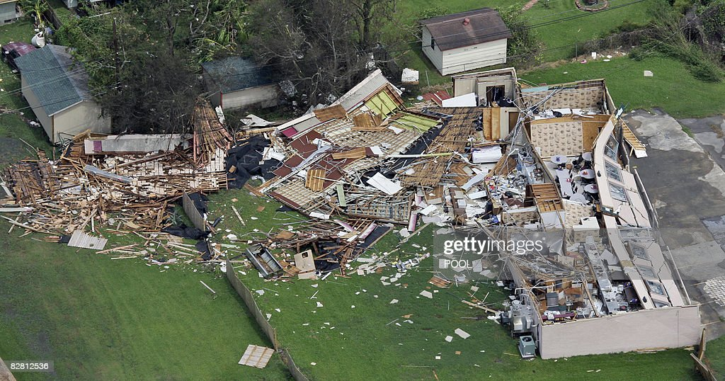 A building's debris is scattered after collapsing from Hurricane Ike passing through September 14 2008 in near Winnie Texas Floodwaters from...
