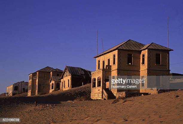 Buildings in deserted diamond mining settlement Kolmanskop Namibia Africa