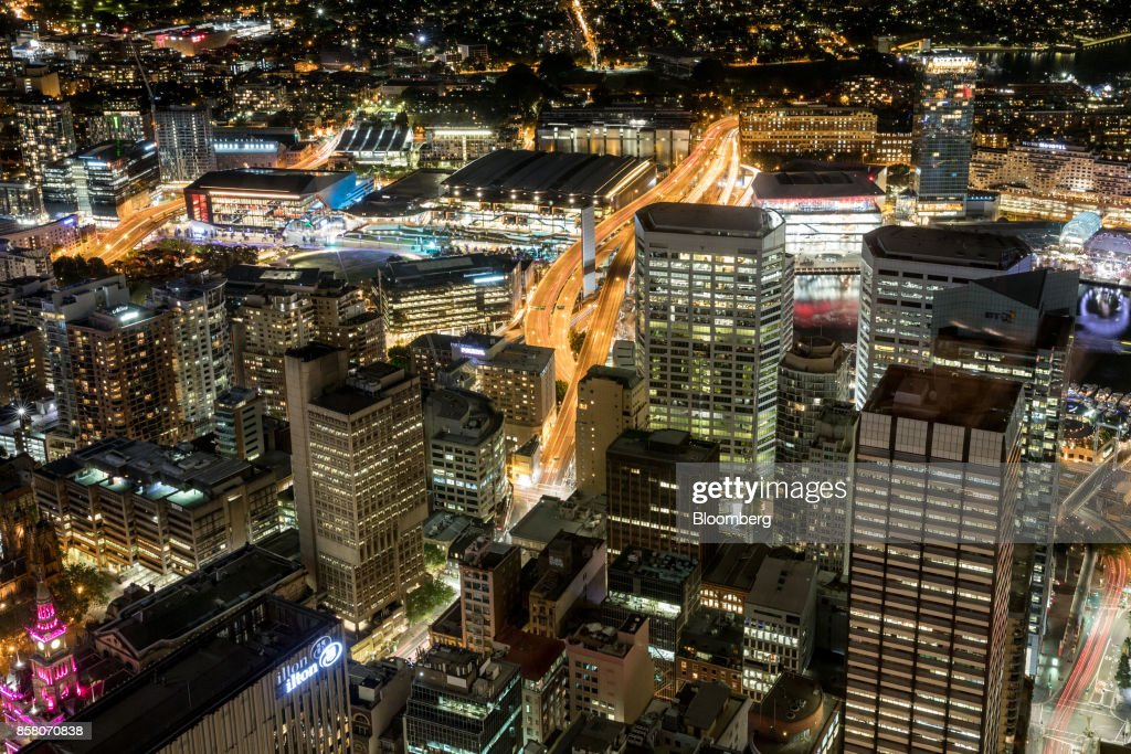 Buildings in the financial district stand illuminated at night in Sydney, Australia, on Friday, Sept. 29, 2017. A bungled transition from coal to clean energy has left resource-rich Australia with an unwanted crown: the highest power prices in the world. Photographer: Cole Bennetts/Bloomberg via Getty Images
