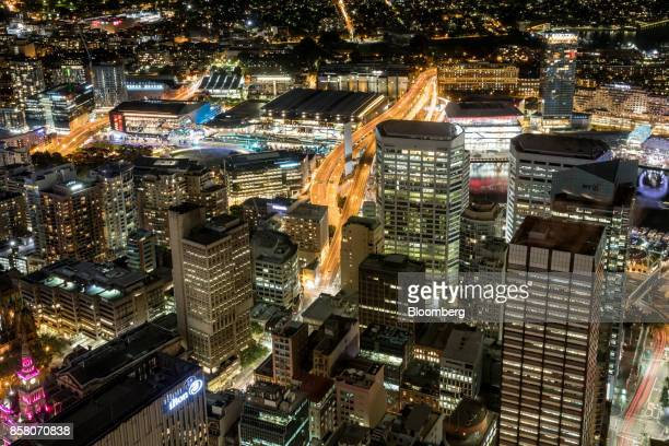 Buildings in the financial district stand illuminated at night in Sydney Australia on Friday Sept 29 2017 A bungled transition from coal to clean...