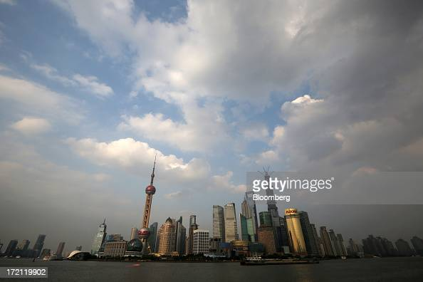 Buildings in the Lujiazui district are seen from the Bund area of Shanghai China on Sunday June 30 2013 China's President Xi Jinping said officials...
