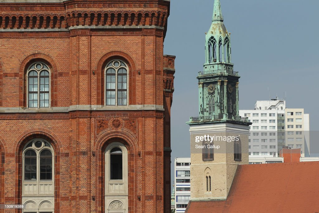Buildings including the 19th-century Rotes Rathaus city hall (L), the 18th-century St. Marienkirche church (though it foundations date back to the 13th century) and a 20th-century East German apartment building stand on August 29, 2012 in Berlin, Germany. The city of Berlin is currently holding a series of exhibitions and events ahead of its 775th anniversary, which it will celebrate at the end of October.
