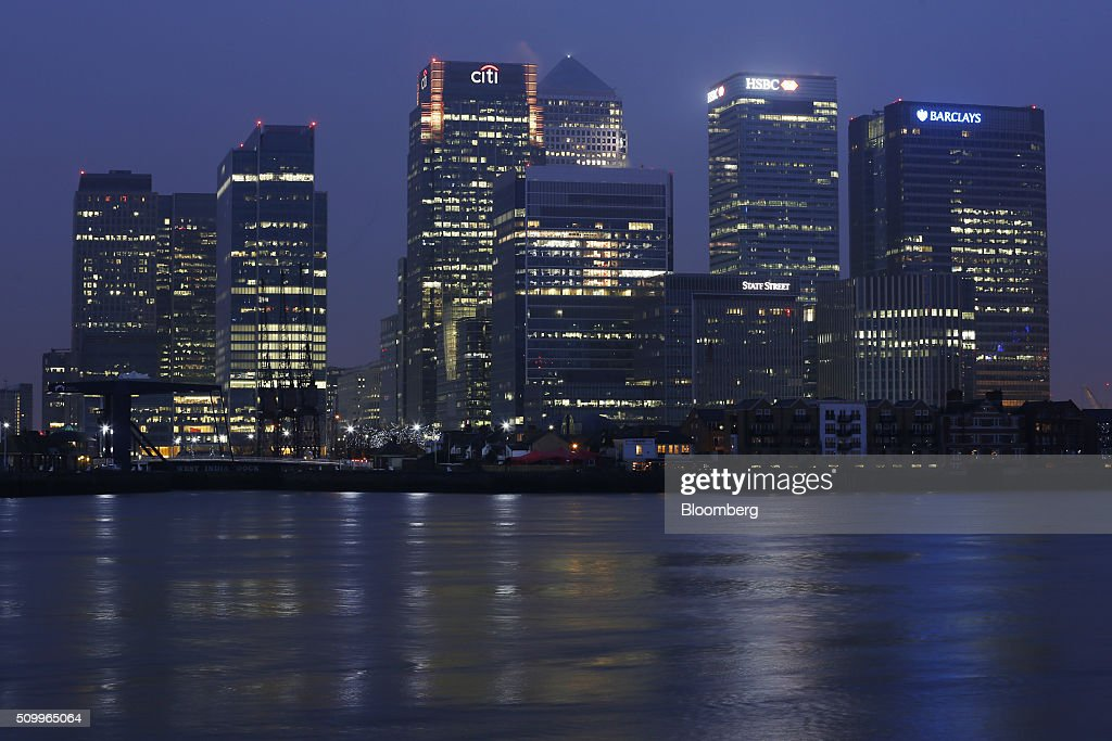 Buildings, including the Citigroup Inc. offices, left, the HSBC Holdings Plc headquarters, center, and the Barclays Plc., headquarters, right, stand in the Canary Wharf business, financial and shopping district, on the banks of the River Thames at dawn, in London, U.K., on Saturday, Feb. 13, 2016. HSBC's board will meet on Sunday to decide whether to shift its headquarters from London, according to two people with knowledge of the decision. Photographer: Luke MacGregor/Bloomberg via Getty Images