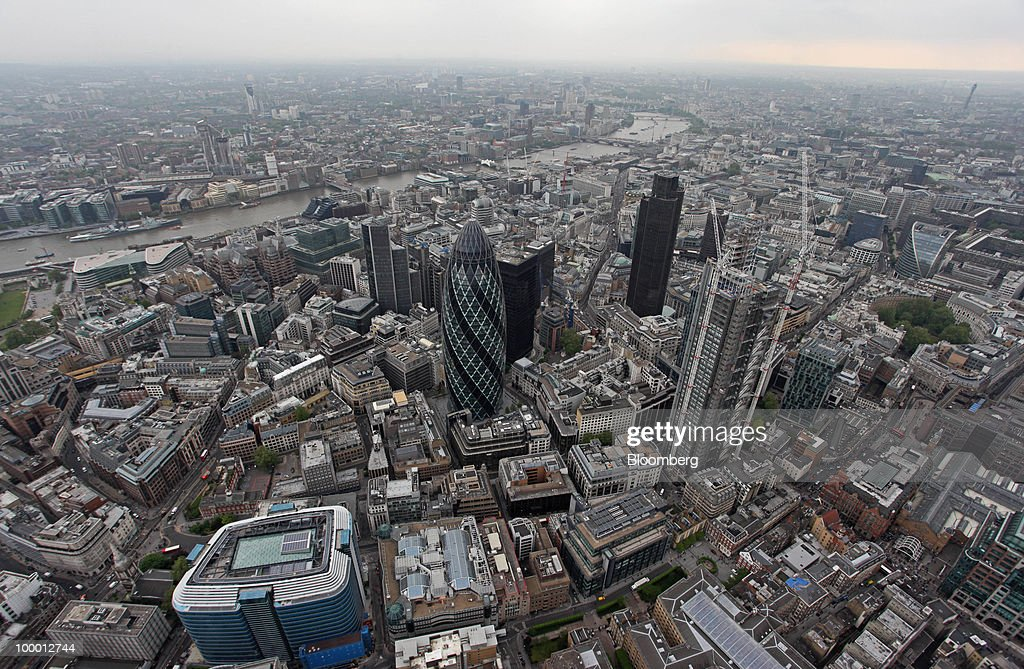 Buildings including the Tower 42 and the Swiss Re building, also known as the 'Gherkin,' sit in the city's financial district in London, U.K., on Wednesday, May 19, 2010. Job vacancies at London financial-services companies fell 12 percent in April as Britain headed into elections that resulted in a coalition government and the European Union struggled to cut deficits. Photographer: Chris Ratcliffe/Bloomberg via Getty Images