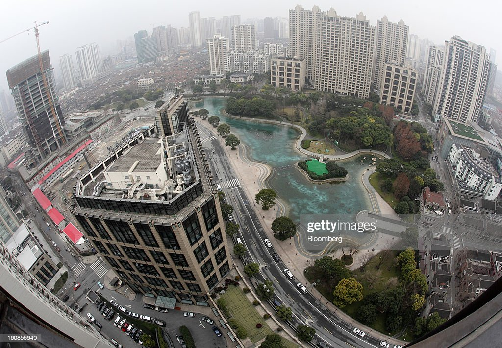 Buildings including Tower 2 of the Corporate Avenue development, center left, and residential buildings at Lakeville Regency, background center right, both developed by Shui On Land Ltd., stand in Shanghai, China, on Wednesday, Feb. 6, 2013. China's economic growth accelerated for the first time in two years as government efforts to revive demand drove a rebound in industrial output, retail sales and the housing market. Photographer: Tomohiro Ohsumi/Bloomberg via Getty Images