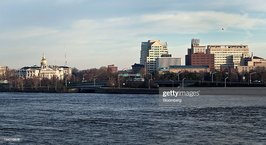 Buildings line the Delaware river in Trenton New Jersey US on Sunday Nov 27 2011 Trenton the New Jersey capital and onetime factory hub where 23...
