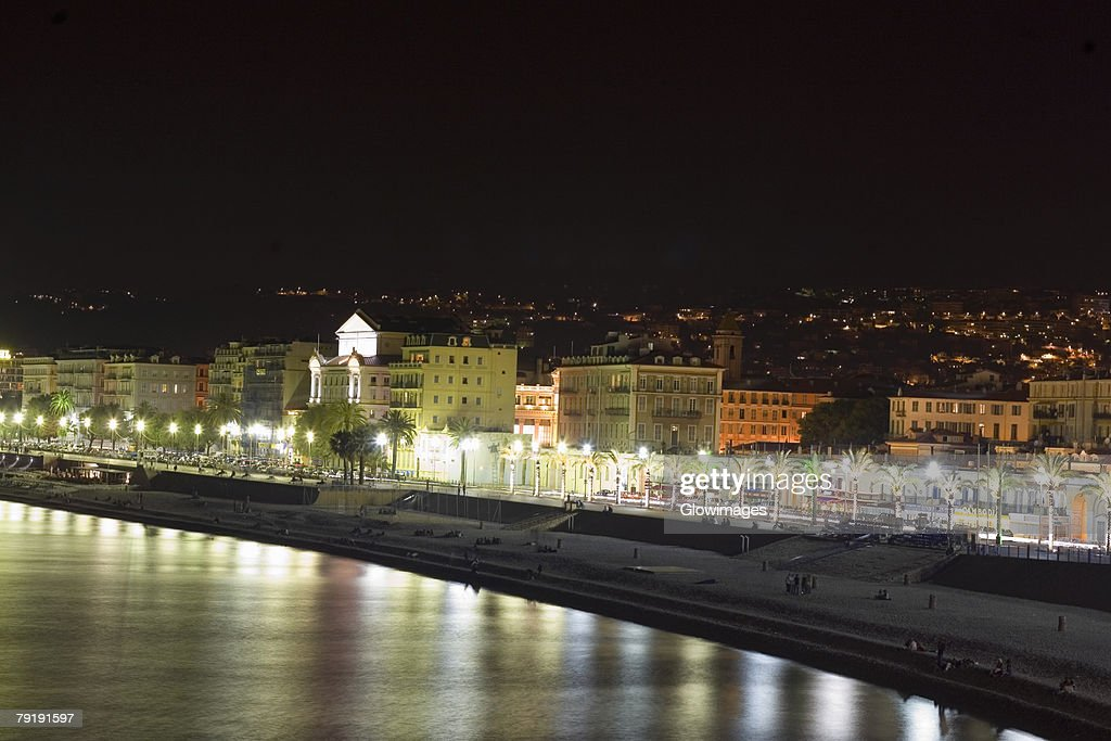 Buildings lit up at night, Nice, France : Foto de stock