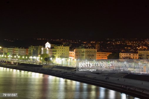 Buildings lit up at night, Nice, France : Stock Photo