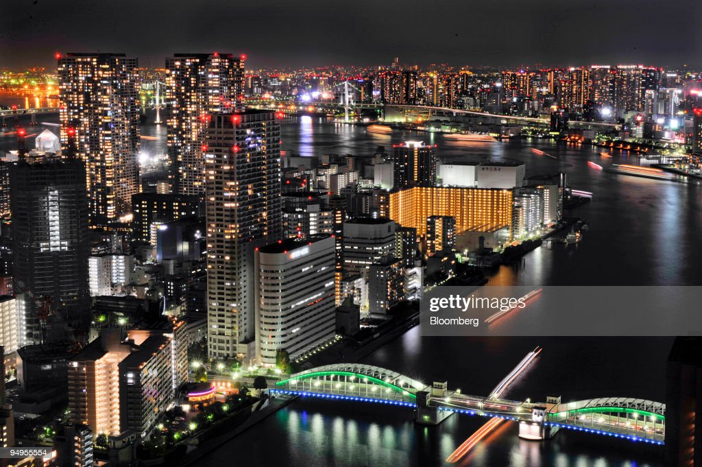 Buildings near Harumi pier are illuminated at night in Tokyo Japan on Sunday Sept 13 2009 Commercial buildings stand at night in Tokyo Japan on...