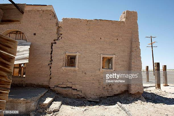 Buildings of an apparent hot mineral spring spa on a mud flat in the thermal fields of the southern San Andreas Fault at the Salton Sea have fallen...