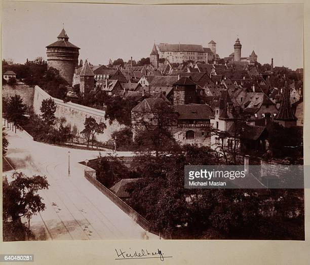Buildings of Heidelberg Germany The houses have tiled roofs and a fortress is visible beyond the houses Ca 1890