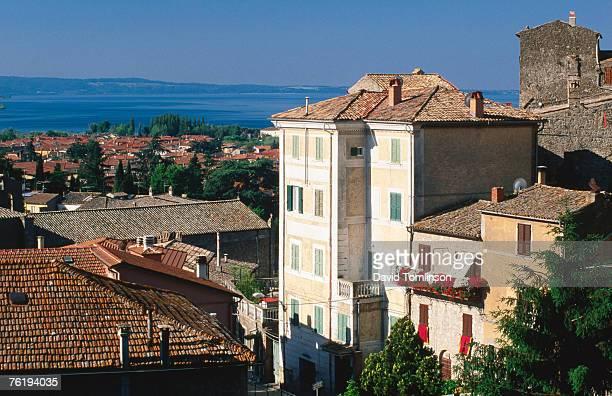 Buildings of village with Lake Bolsena beyond, Bolsena, Lazio, Italy, Europe