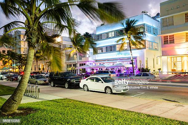 Buildings on Ocean Drive illuminated at night, South Beach, Miami, Florida, USA