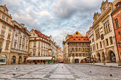 Buildings on the Old Town square Staromestska Namesti in Prague during sunrise, Czech Republic.