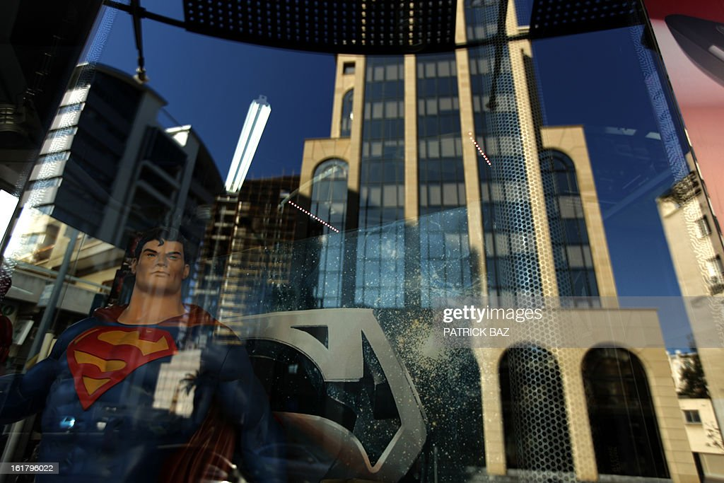 Buildings reflect in a shop window decorated with a dummy of Superman in Nicosia central business district on February 16, 2013, in Cyprus. Eurozone finance ministers meeting on February 11 in Brussels postponed the decision on aid until after Cyprus' presidential election, whose first round begins on on February 17.