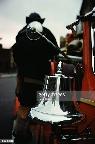 Buildings reflected in the bell on a fire engine New York City circa 1960