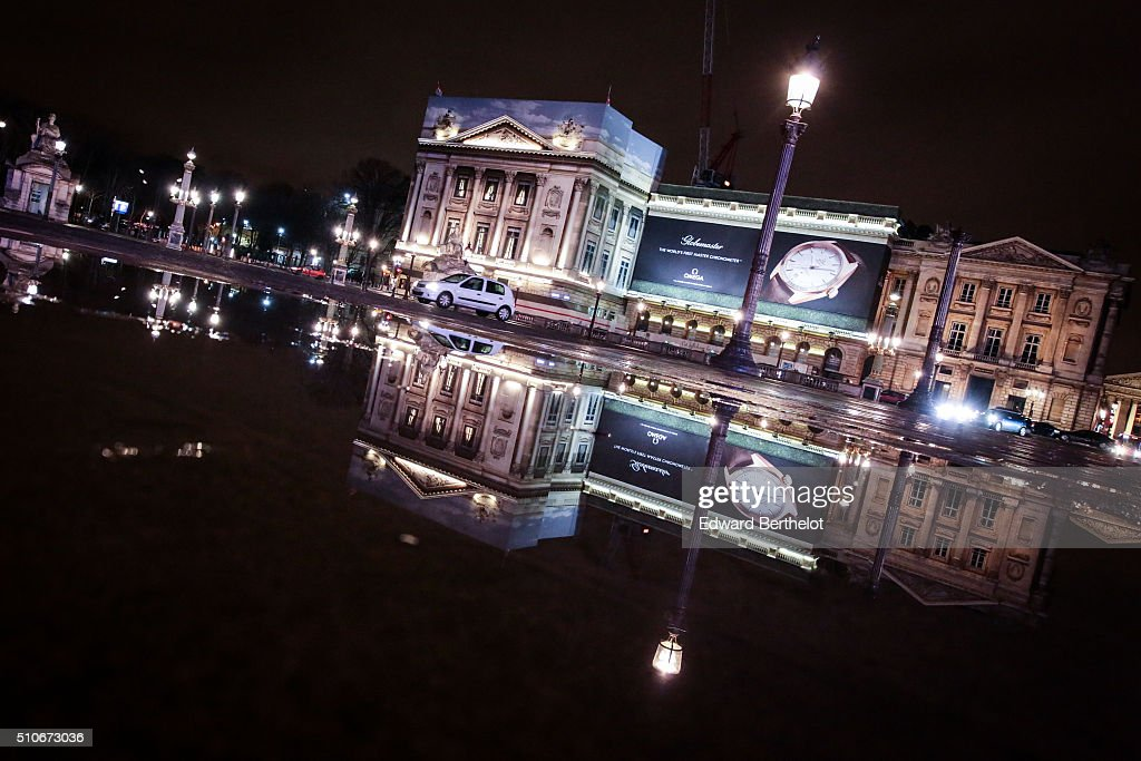 Buildings reflecting into a puddle on Place de La Concorde on February 4 2016 in Paris France