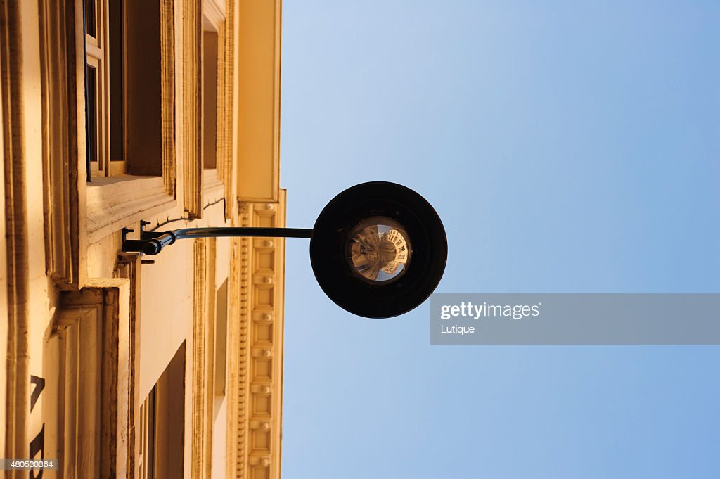 Building's reflection in street lantern : Stock Photo