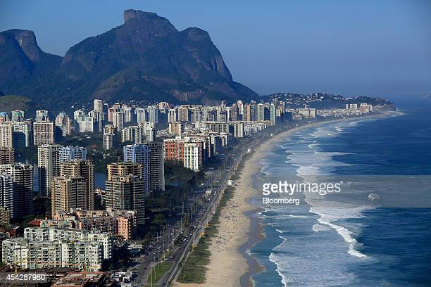 Buildings stand along the beach in the Barra da Tijuca neighborhood where the 2016 Summer Olympics will be held in this aerial photo taken in Rio de...