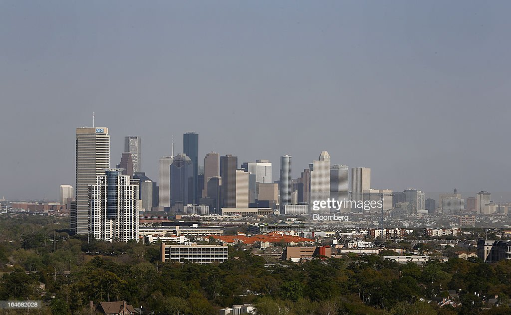 Buildings stand along the skyline of Houston in Houston, Texas, U.S., on Monday, March 18, 2013. Office sales in Houston, the fourth-largest U.S. city, jumped 32 percent last year to $3.89 billion, the highest total in five years and outpacing the 21 percent gain for the entire U.S., according to the research firm Real Capital Analytics. Photographer: Aaron M. Sprecher/Bloomberg via Getty Images