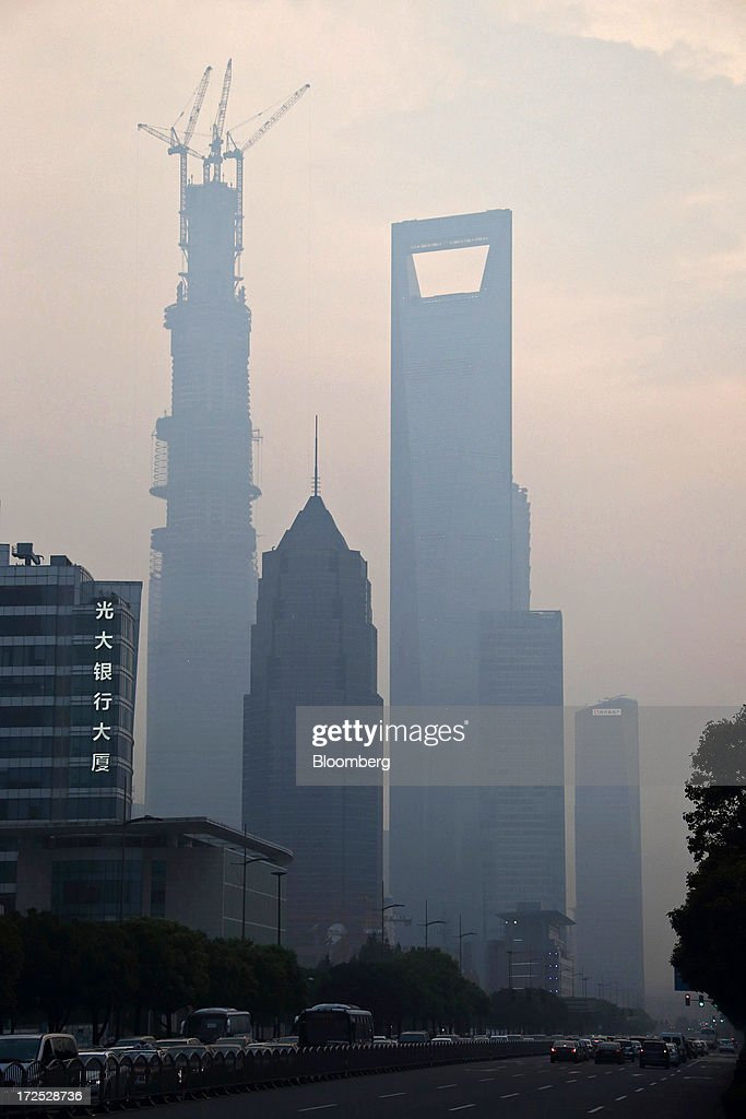 Buildings stand at dusk in the Lujiazui financial district in Shanghai, China, on Monday, July 1, 2013. Chinese banks' valuations are close to their lowest on record as the nation's interbank funding crisis exacerbated investors' concern that earnings growth will stall and defaults may surge as the economy slows. Photographer: Tomohiro Ohsumi/Bloomberg via Getty Images