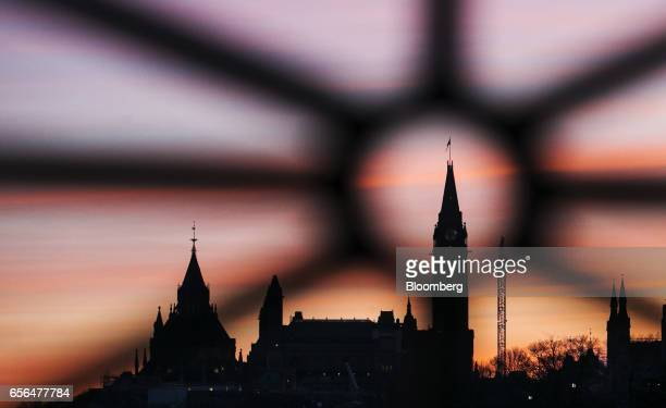 Buildings stand at sunrise on Parliament Hill in Ottawa Ontario Canada on Monday March 20 2017 Trudeau's finance chief Bill Morneau will release his...