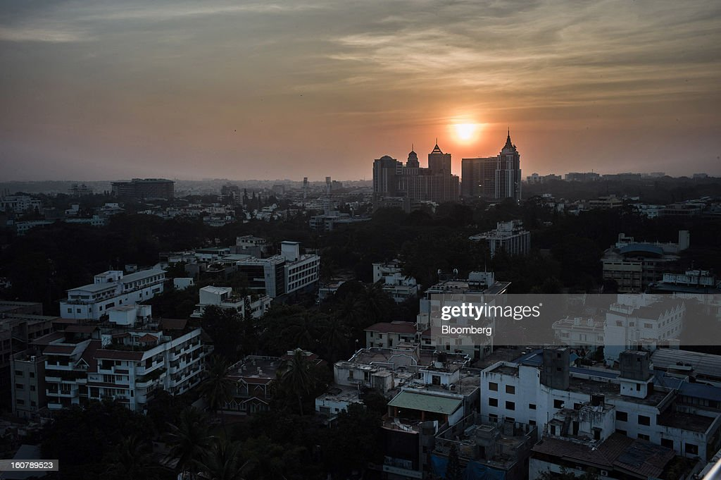 Buildings stand at sunset in Bangalore, India, on Monday, Feb. 4, 2013. India's monetary authority predicted that the economy will expand 5.5 percent in the year ending March 31, which would be the smallest gain since 2003. Photographer: Sanjit Das/Bloomberg via Getty Images