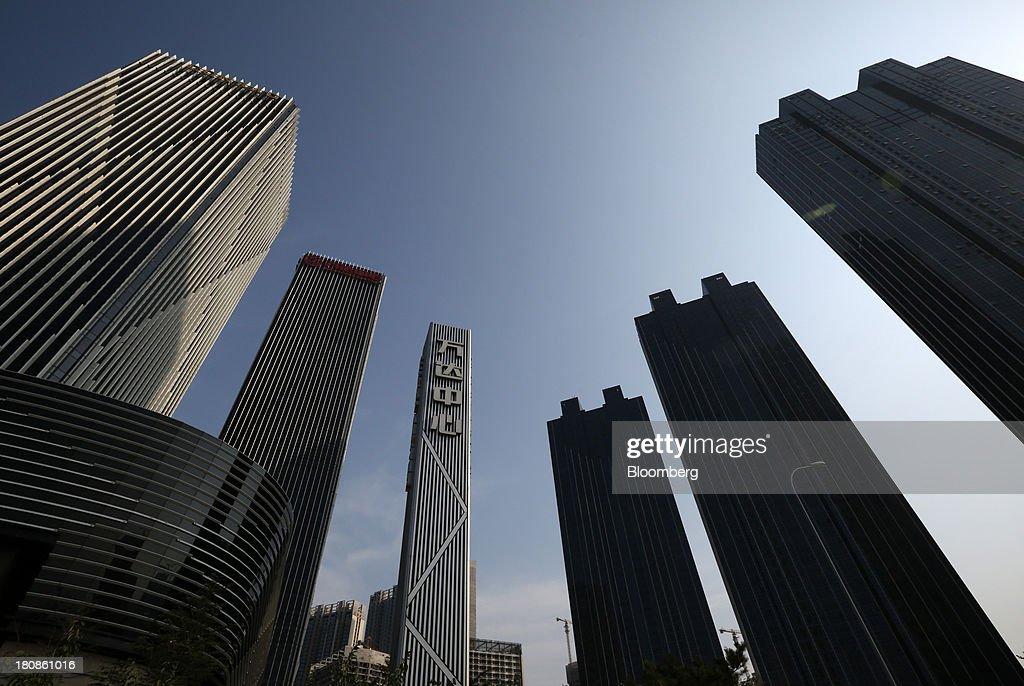 Buildings stand at the Dalian Wanda Center in Dalian, China, on Friday, Sept. 13, 2013. Goldman Sachs Group Inc. this month raised its estimate for China's economic growth for the third and fourth quarters, citing improving global demand and a stronger-than-expected domestic industrial recovery. Photographer: Tomohiro Ohsumi/Bloomberg via Getty Images