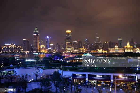 Buildings stand illuminated at night in the Bund area background in Shanghai China on Friday June 28 2013 China's President Xi Jinping said officials...