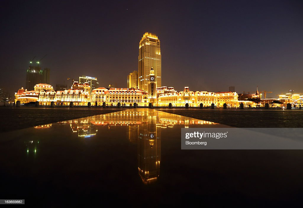 Buildings stand illuminated at night in Tianjin, China, on Wednesday, March 13, 2013. China's money-market rate rose to a one-week high after central bank Governor Zhou Xiaochuan said yesterday the nation should be on 'high alert' over inflation. Photographer: Tomohiro Ohsumi/Bloomberg via Getty Images