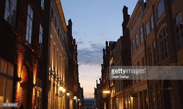 Buildings stand illuminated in the city center August 20 2007 in Luebeck Germany Warner Brothers is shooting a film adaptation of 'Buddenbrooks' with...