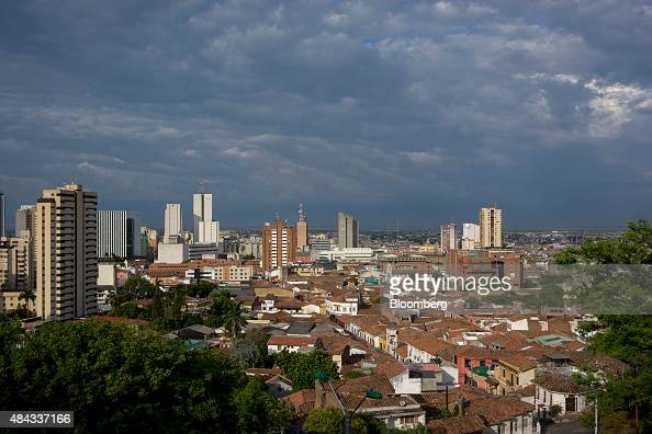 Buildings stand in Cali Colombia on Wednesday Aug 12 2015 Colombia's central bank last month cut its forecast for 2015 economic growth to 28 percent...