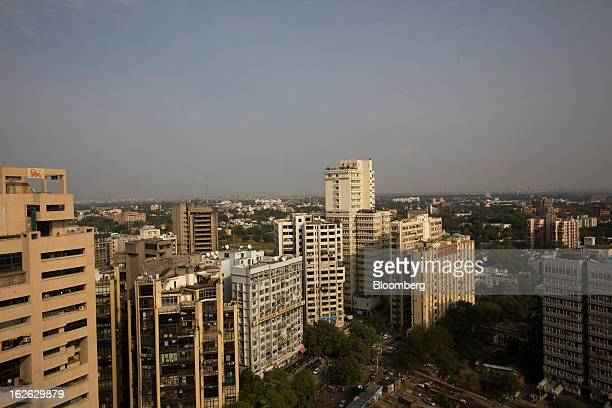 Buildings stand in Connaught Place in New Delhi India on Saturday Feb 23 2013 Finance Minister Palaniappan Chidambaram who will present his annual...