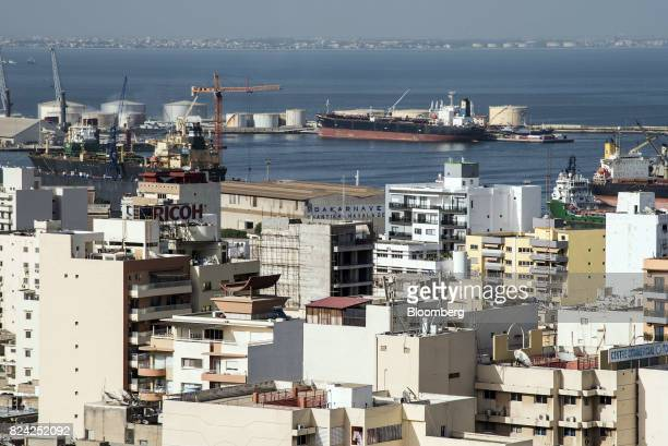 Buildings stand in front of a tanker at the Port of Dakar in Dakar Senegal on Friday July 28 2017 Senegalese voters will elect a new parliament on...