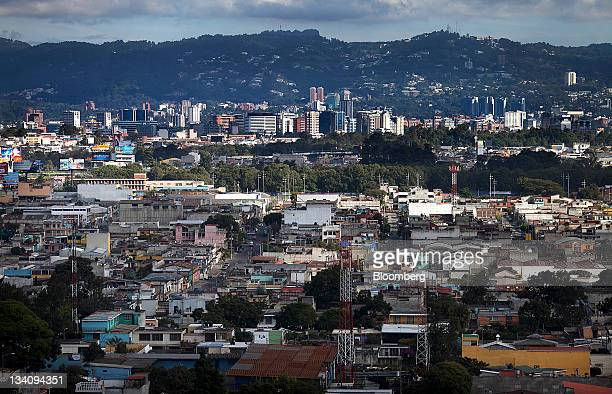 Buildings stand in Guatemala City Guatemala on Wednesday Nov 23 2011 Foreign direct investment in Guatemala will stagnate this year at about $668...