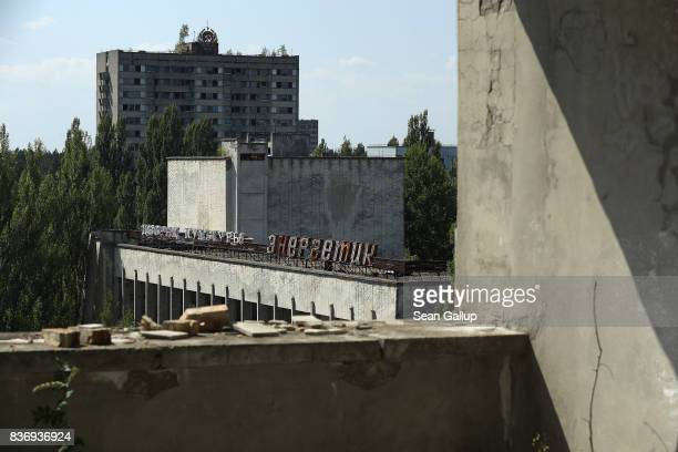 Buildings stand in the abandoned city of Pripyat near the Chernobyl nuclear power plant on August 18 2017 in Pripyat Ukraine An estimated 900 stray...