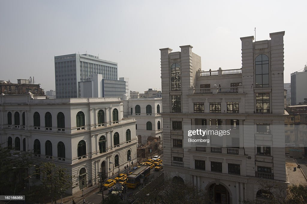 Buildings stand in the BBD Bagh area of Kolkata, India, on Tuesday, Feb. 19, 2013. India's slowest economic expansion in a decade is limiting profit growth at the biggest companies even as foreigners remain net buyers of the nation's stocks, according to Kotak Institutional Equities. Photographer: Brent Lewin/Bloomberg via Getty Images