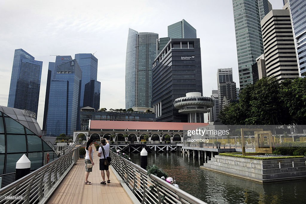 Buildings stand in the central business district in Singapore, on Saturday, Dec. 29, 2012. Singapore may grapple with elevated inflationary pressures for a third year in 2013, reducing scope for the central bank to provide stimulus to an economy that probably entered a technical recession this quarter. Photographer: Munshi Ahmed/Bloomberg via Getty Images