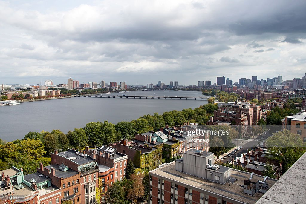 Buildings stand in the city skyline of Boston Massachusetts US back right across the Charles River from Cambridge Massachusetts left on Tuesday Oct 7...